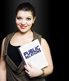 Smiling woman with public relations folder Royalty Free Stock Image