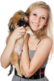 Smiling woman with a puppy Royalty Free Stock Photos