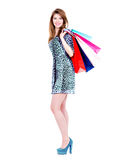 Smiling woman with purchasing. Beautiful smiling woman with purchasing in casual - isolated on a white background Royalty Free Stock Photos