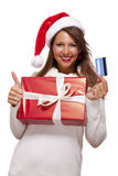Smiling woman purchasing Christmas gifts Royalty Free Stock Images