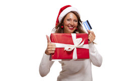 Smiling woman purchasing Christmas gifts Royalty Free Stock Photo