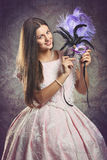 Smiling woman with purple venetian mask Royalty Free Stock Photo