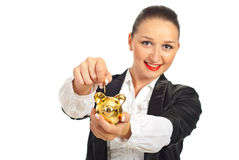 Smiling woman put coin in piggybank Stock Photos