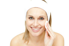 Smiling woman putting foundation cream Stock Photos