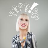 Smiling woman with questions mark above head. Looking up stock images