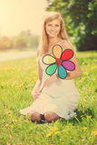 Smiling woman with a rainbow flower outdoors Royalty Free Stock Photos