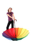 Smiling woman with rainbow umbrella Royalty Free Stock Image
