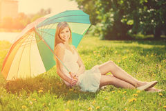 Smiling woman with a rainbow umbrella outdoors Royalty Free Stock Photos