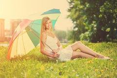 Smiling woman with a rainbow umbrella outdoors Stock Photography