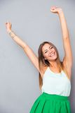 Smiling woman with raised hands up Stock Photos