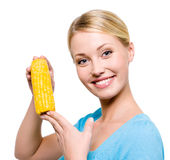 Smiling woman with raw corn. Portrait of a young beautiful woman with raw corn - isolated on white Stock Photo