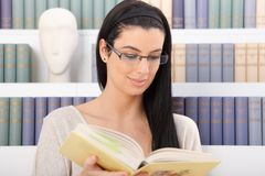 Smiling woman reading Stock Photos