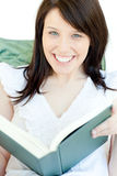 Smiling woman reading a book Stock Photo
