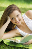 Smiling woman reading book Royalty Free Stock Photography