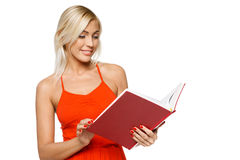 Smiling woman reading a book Royalty Free Stock Image