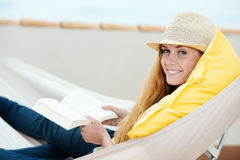 Smiling Woman Reading Book In Hammock Royalty Free Stock Photography