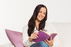 Smiling woman reading a book Stock Photos