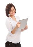 Smiling woman reading on an electronic tablet Stock Images