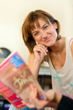 Smiling Woman Reading with a Friend Royalty Free Stock Photos