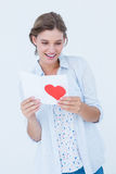 Smiling woman reading love letter Royalty Free Stock Photo