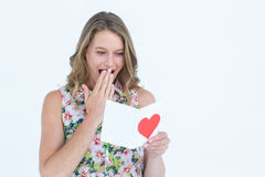 Smiling woman reading love letter Stock Photo