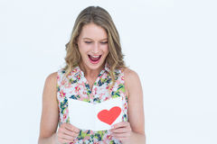 Smiling woman reading love letter Royalty Free Stock Image