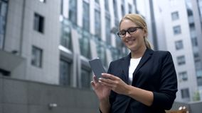 Smiling woman reading message in social network, dating website application. Stock photo royalty free stock images