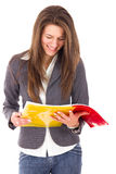 Smiling woman reading notes royalty free stock images
