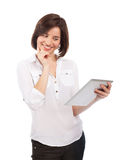 Smiling woman reading on a touchpad Royalty Free Stock Photography
