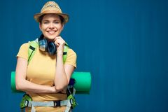 Smiling woman ready for travel wit backpack. Stock Image