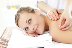 Smiling woman receiving an acupuncture treatment. Smiling blond woman receiving an acupuncture treatment in a health spa Royalty Free Stock Photo
