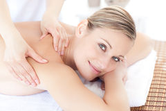 Smiling woman receiving a back massage Royalty Free Stock Photos