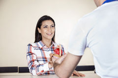 Smiling Woman Receiving Ice Cream From Waiter Stock Image