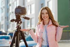 Smiling woman recording a video royalty free stock photography