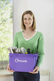 Smiling Woman With Recycling Container Royalty Free Stock Images
