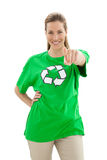 Smiling woman in recycling symbol t-shirt pointing at camera. Smiling young woman in recycling symbol t-shirt pointing at camera over white background Royalty Free Stock Photo