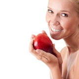 Smiling woman with red apple - isolated Royalty Free Stock Photo