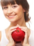 Smiling woman with red apple Stock Photography