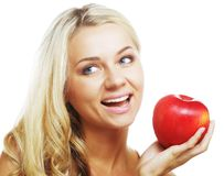 Smiling woman with red apple Royalty Free Stock Images