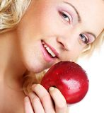 Smiling woman with red apple Stock Image