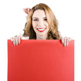 Smiling woman with red blank board Stock Image