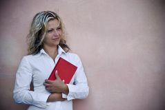 Smiling woman with red book Royalty Free Stock Photography