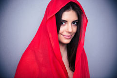 Smiling woman in red cloth looking at camera Royalty Free Stock Photography