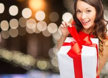 Smiling woman in red dress with christmas gift box Stock Photo