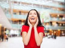 Smiling woman in red dress Stock Image