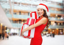 Smiling woman in red dress with gift box Stock Images