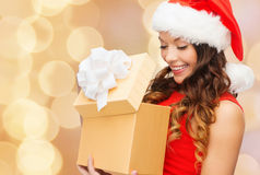 Smiling woman in red dress with gift box Stock Photos