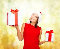 Smiling woman in red dress with gift box Stock Image