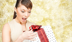 Smiling woman in red dress with gift box Royalty Free Stock Image