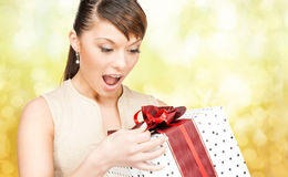 Smiling woman in red dress with gift box Royalty Free Stock Photo